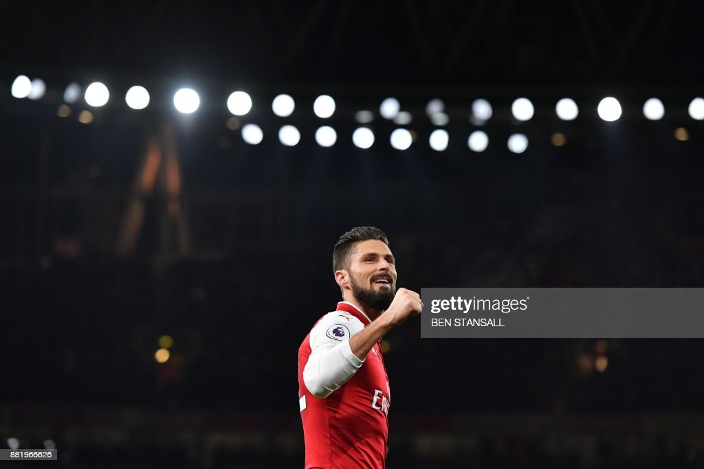 TOPSHOT - Arsenal's French striker Olivier Giroud celebrates scoring their second goal during the English Premier League football match between Arsenal and Huddersfield Town at the Emirates Stadium in London on November 29, 2017. / AFP PHOTO / Ben STANSALL / RESTRICTED TO EDITORIAL USE. No use with unauthorized audio, video, data, fixture lists, club/league logos or 'live' services. Online in-match use limited to 75 images, no video emulation. No use in betting, games or single club/league/player publications. /