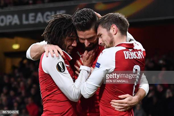 TOPSHOT Arsenal's French striker Olivier Giroud celebrates with teammates scoring a penalty the fifth goal during the Europa League Group H stage...
