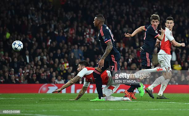 Arsenal's French striker Olivier Giroud dives to score his team's first goal during the UEFA Champions League football match between Arsenal and...