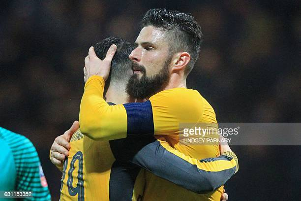 Arsenal's French striker Olivier Giroud embraces Arsenal's Swiss midfielder Granit Xhaka on the pitch after the English FA Cup third round football...