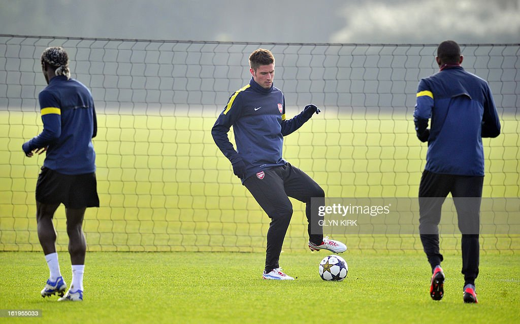 Arsenal's French striker Olivier Giroud (C) is seen training for the forthcoming UEFA Champions League round of 16 football match against Bayern Munich at Arsenal's training ground, London Colney, North London, England on February 18, 2013.