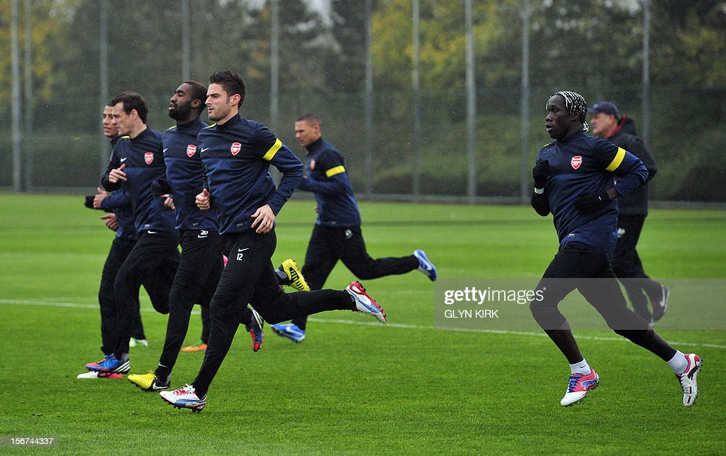 Arsenal's French striker Olivier Giroud (L) joins team mates in training at Arsenal's training facility in London Colney in Hertfordshire north of London on November 20, 2012 on the eve of their UEFA Champions League group B football match against Montpellier.