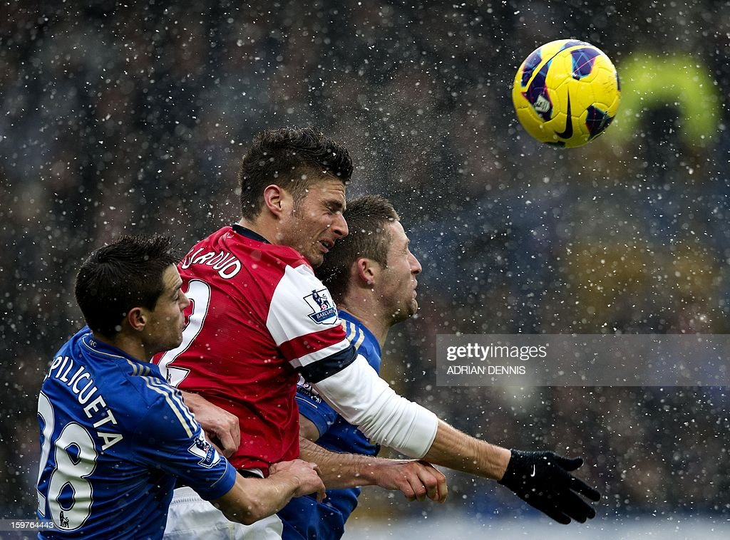 """Arsenal's French striker Olivier Giroud (C) jumps for the ball against Chelsea's English defender Gary Cahill (R) and Chelsea's Spanish defender Cesar Azpilicueta (L) during the English Premier League football match between Chelsea and Arsenal at Stamford Bridge in London on January 20, 2013. USE. No use with unauthorized audio, video, data, fixture lists, club/league logos or """"live"""" services. Online in-match use limited to 45 images, no video emulation. No use in betting, games or single club/league/player publications."""