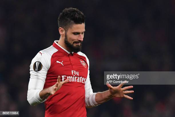 Arsenal's French striker Olivier Giroud reacts after he misses an oppurtunity at goal during the UEFA Europa League Group H football match between...