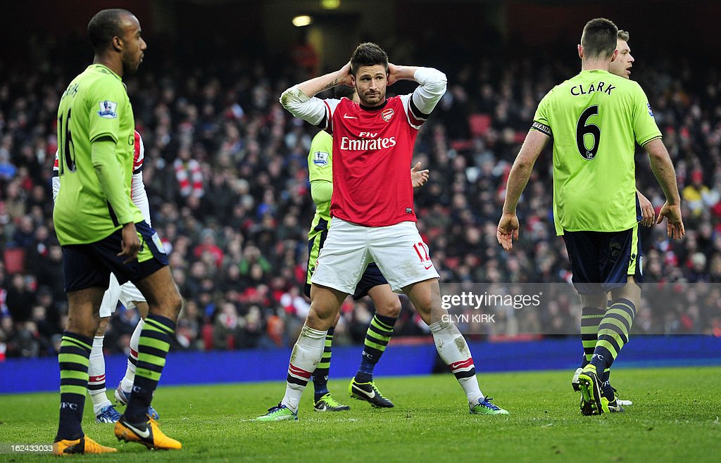 Arsenal's French striker Olivier Giroud (C) reacts after missing a chance during the English Premier League football match between Arsenal and Aston Villa at the Emirates Stadium in London on February 23, 2013. Arsenal won the game 2-1. USE. No use with unauthorized audio, video, data, fixture lists, club/league logos or 'live' services. Online in-match use limited to 45 images, no video emulation. No use in betting, games or single club/league/player publications.