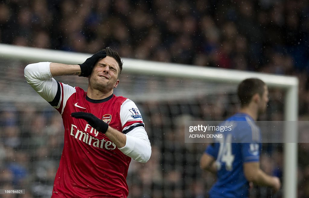 """Arsenal's French striker Olivier Giroud (L) reacts after missing a shot at goal against Chelsea during the English Premier League football match between Chelsea and Arsenal at Stamford Bridge in London on January 20, 2013. USE. No use with unauthorized audio, video, data, fixture lists, club/league logos or """"live"""" services. Online in-match use limited to 45 images, no video emulation. No use in betting, games or single club/league/player publications."""