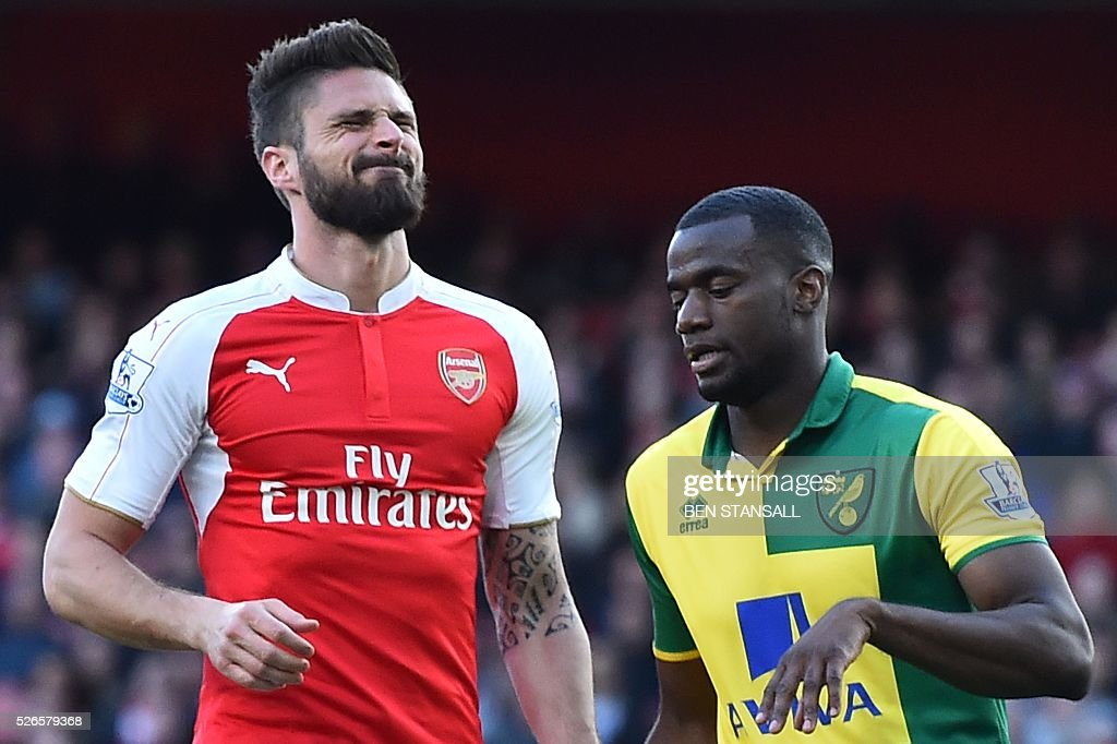 Arsenal's French striker Olivier Giroud reacts during the English Premier League football match between Arsenal and Norwich at the Emirates Stadium in London on April 30, 2016. / AFP / BEN STANSALL / RESTRICTED TO EDITORIAL USE. No use with unauthorized audio, video, data, fixture lists, club/league logos or 'live' services. Online in-match use limited to 75 images, no video emulation. No use in betting, games or single club/league/player publications. /