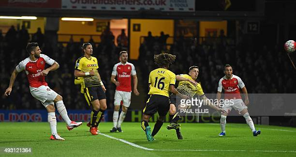 Arsenal's French striker Olivier Giroud shoots to score their second goal during the English Premier League football match between Watford and...