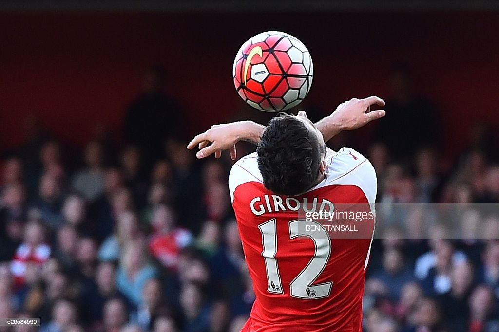 Arsenal's French striker Olivier Giroud tries to head the ball during the English Premier League football match between Arsenal and Norwich at the Emirates Stadium in London on April 30, 2016. / AFP / BEN STANSALL / RESTRICTED TO EDITORIAL USE. No use with unauthorized audio, video, data, fixture lists, club/league logos or 'live' services. Online in-match use limited to 75 images, no video emulation. No use in betting, games or single club/league/player publications. /
