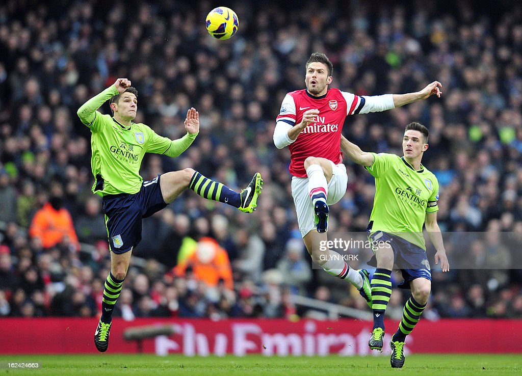 Arsenal's French striker Olivier Giroud (C) vies with Aston Villa's English defender Matthew Lowton (L) during the English Premier League football match between Arsenal and Aston Villa at the Emirates Stadium in London on February 23, 2013. USE. No use with unauthorized audio, video, data, fixture lists, club/league logos or 'live' services. Online in-match use limited to 45 images, no video emulation. No use in betting, games or single club/league/player publications.