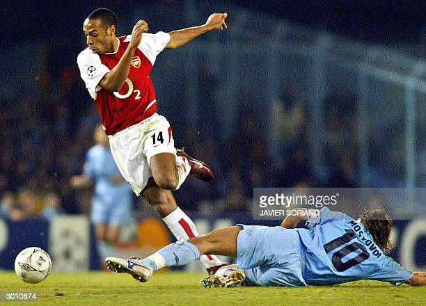 Arsenal's French striker Thierry Henry outpasses Vigo's Russian striker Alexander Mostovoi during their Champions League first leg football at...