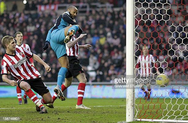 Arsenal's French striker Thierry Henry scores their 2nd goal during the English Premier League football match between Sunderland and Arsenal at The...