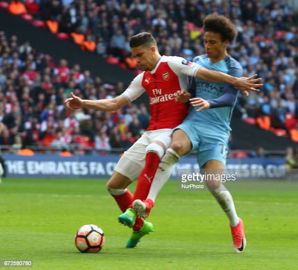Arsenal's Gabriel Paulista holds of Manchester City's Leroy Sane during The Emirates FA Cup SemiFinal match between Arsenal and Manchester City at...