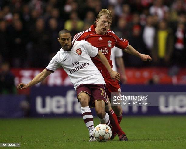 Arsenal's Gael Clichy and Liverpool's Dirk Kuyt battle for the ball