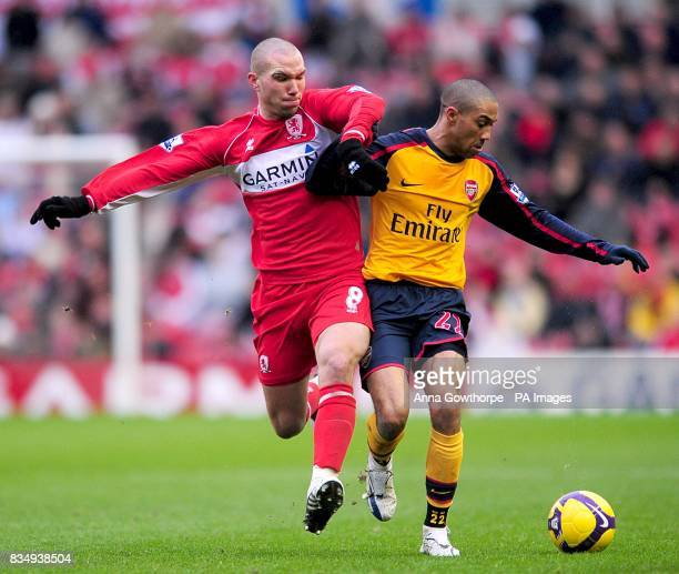 Arsenal's Gael Clichy and Middlesbrough's Didier Digard battle for the ball