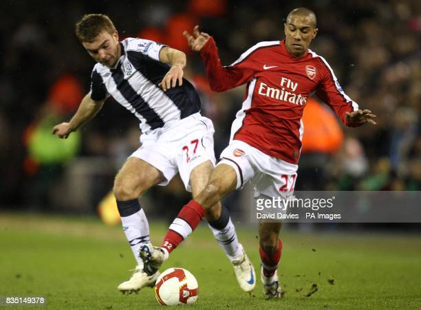Arsenal's Gael Clichy and West Bromwich Albion's James Morrison battle for the ball