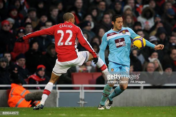 Arsenal's Gael Clichy and West Ham United's David Di Michele battle for the ball