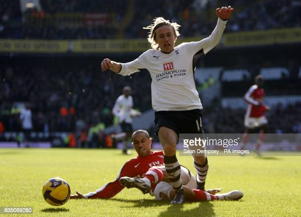 Arsenal's Gael Clichy challenges Tottenham Hotspur's Luka Modric for the ball