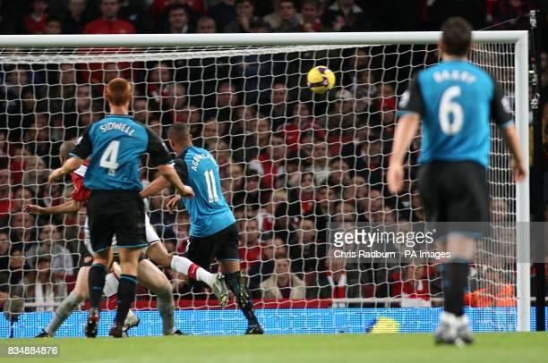 Arsenal's Gael Clichy heads in an own goal