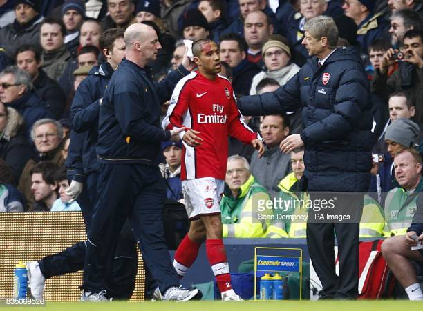 Arsenal's Gael Clichy is greated by manager Arsene Wenger as he comes off the pitch following an injury