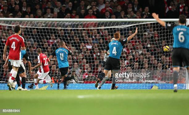 Arsenal's Gael Clichy reacts after heading in an own goal