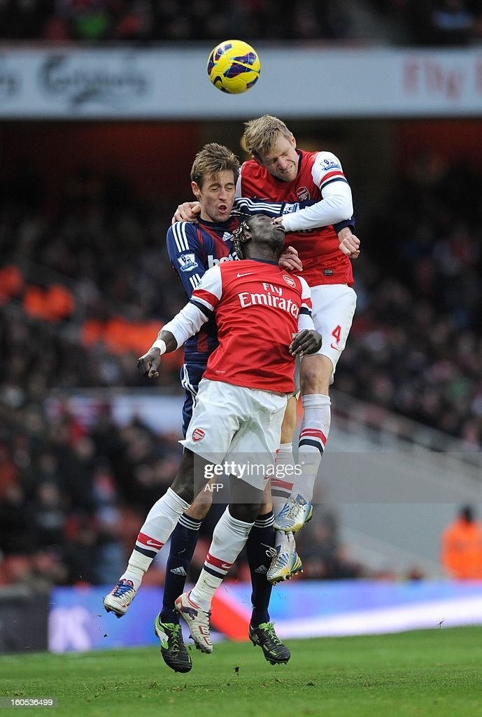 """Arsenal's German defender Per Mertesacker (R) and Arsenal's French defender Bacary Sagna vie with Stoke City's English striker Peter Crouch during the English Premier League football match between Arsenal and Stoke City at the Emirates Stadium in North London, England on Febuary 2, 2013. Arsenal won 1-0. AFP PHOTO/Olly GREENWOOD USE. No use with unauthorized audio, video, data, fixture lists, club/league logos or """"live"""" services. Online in-match use limited to 45 images, no video emulation. No use in betting, games or single club/league/player publications."""