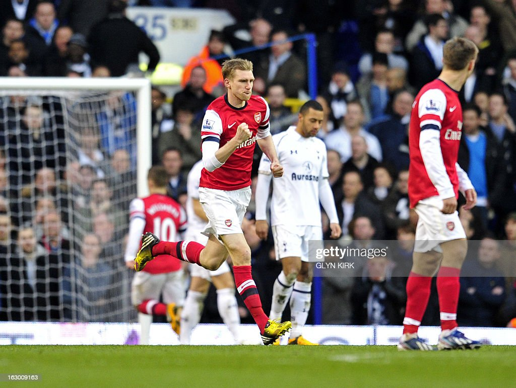 "Arsenal's German defender Per Mertesacker (C) celebrates scoring Arsenal's first goal during the English Premier League football match between Tottenham Hotspur and Arsenal at White Hart Lane in north London on March 3, 2013. USE. No use with unauthorized audio, video, data, fixture lists, club/league logos or ""live"" services. Online in-match use limited to 45 images, no video emulation. No use in betting, games or single club/league/player publications"