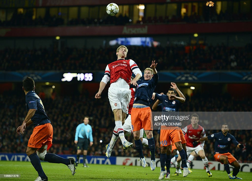Arsenal's German defender Per Mertesacker (L) vies with Montpellier's French striker Gaetan Charbonnier (2L) during the UEFA Champions League group B football match against Montpellier at the Emirates Stadium, North London, on November 21, 2012.