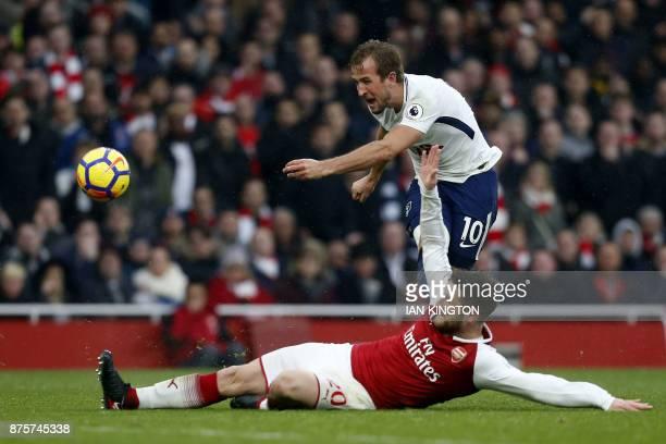 TOPSHOT Arsenal's German defender Shkodran Mustafi blocks a shot by England's striker Harry Kane during the English Premier League football match...