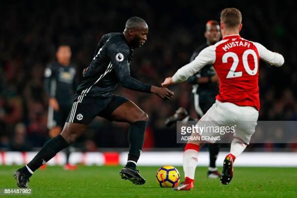 Arsenal's German defender Shkodran Mustafi vies with Manchester United's Belgian striker Romelu Lukaku during the English Premier League football...