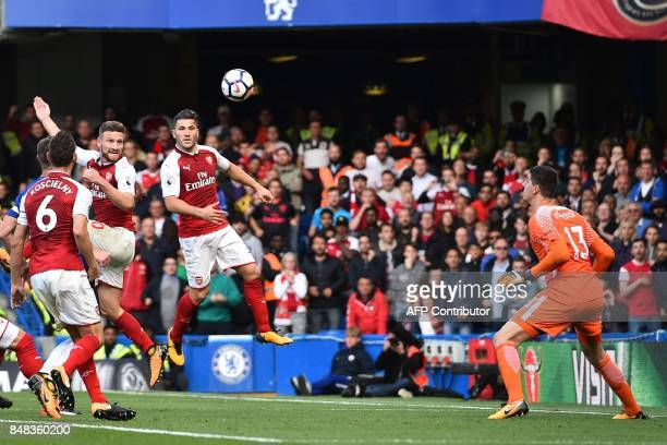 Arsenal's German defender Shkodran Mustafi watches his header beat Chelsea's Belgian goalkeeper Thibaut Courtois but the goal is disallowed for...