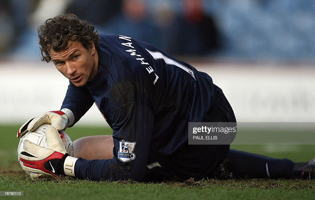Arsenal's German goalkeeper Jens Lehmann makes a save against Burnley during their English FA Cup football match at Turf Moor, Burnley, in northwest England, 06 January 2008. AFP PHOTO/PAUL ELLIS - Mobile and website use of domestic English football pictures are subject to obtaining a Photographic End User Licence from Football DataCo Ltd Tel : +44 (0) 207 864 9121 or e-mail accreditations@football-dataco.com - applies to Premier and Football League matches.