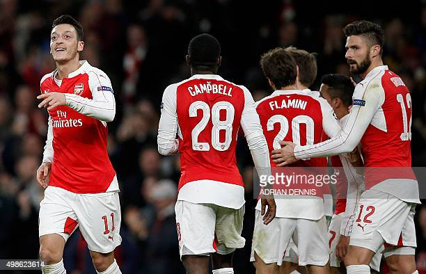 Arsenal's German midfielder Mesut Ozil celebrates after scoring his team's first goal during their UEFA Champions League Group F football match...