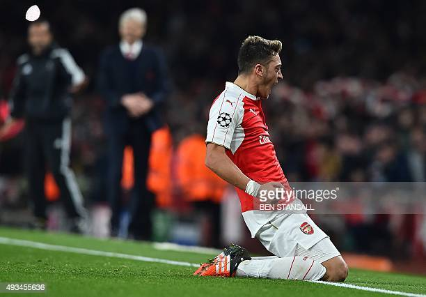 Arsenal's German midfielder Mesut Ozil celebrates scoring his team's second goal during the UEFA Champions League football match between Arsenal and...
