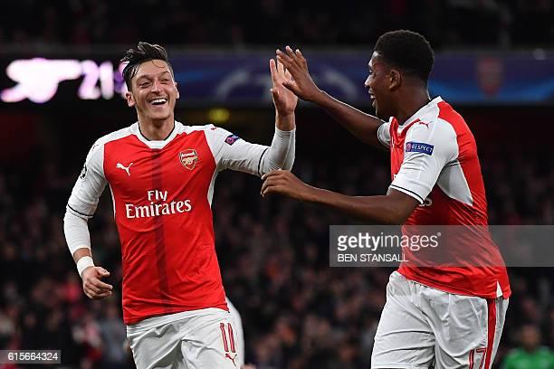 TOPSHOT Arsenal's German midfielder Mesut Ozil celebrates scoring his team's sixth goal with Arsenal's Nigerian striker Alex Iwobi during the UEFA...