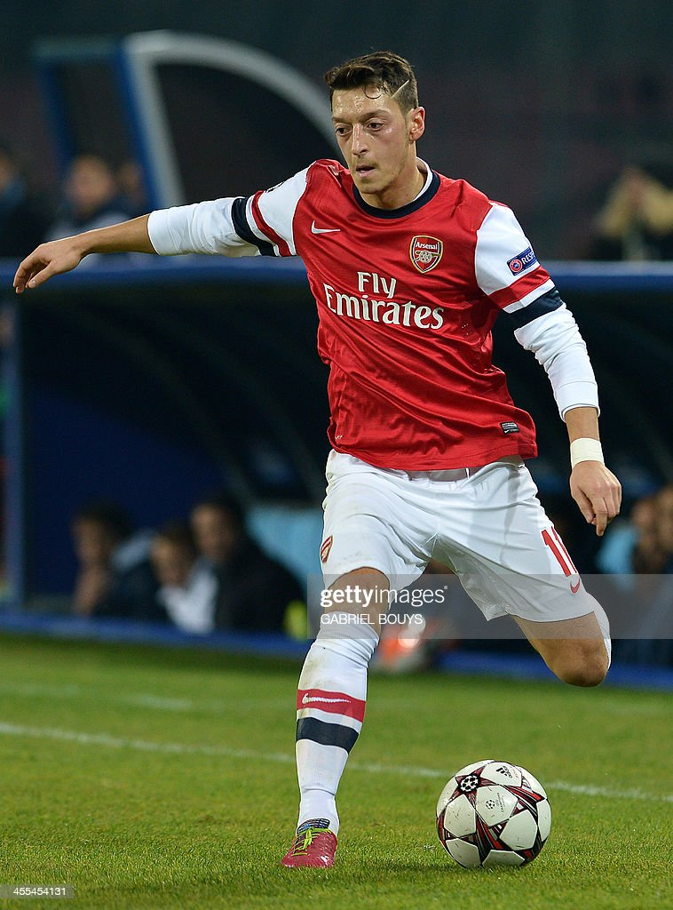 Arsenal's German midfielder Mesut Ozil controls the ball during the UEFA Champions League group F football match between SSC Napoli and Arsenal FC at the San Paolo Stadium in Naples on December 11, 2013.