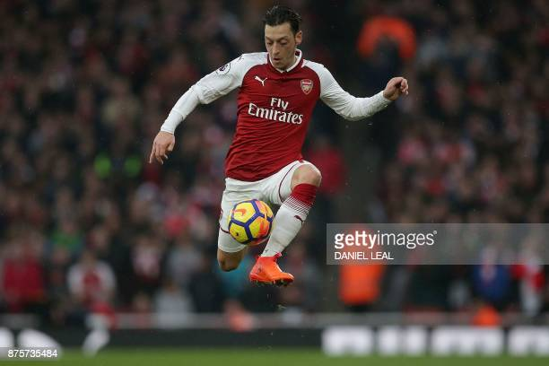 TOPSHOT Arsenal's German midfielder Mesut Ozil controls the ball during the English Premier League football match between Arsenal and Tottenham...