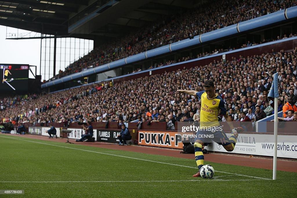 Arsenal's German midfielder Mesut Ozil takes a corner during the English Premier League football match between Aston Villa and Arsenal at Villa Park...