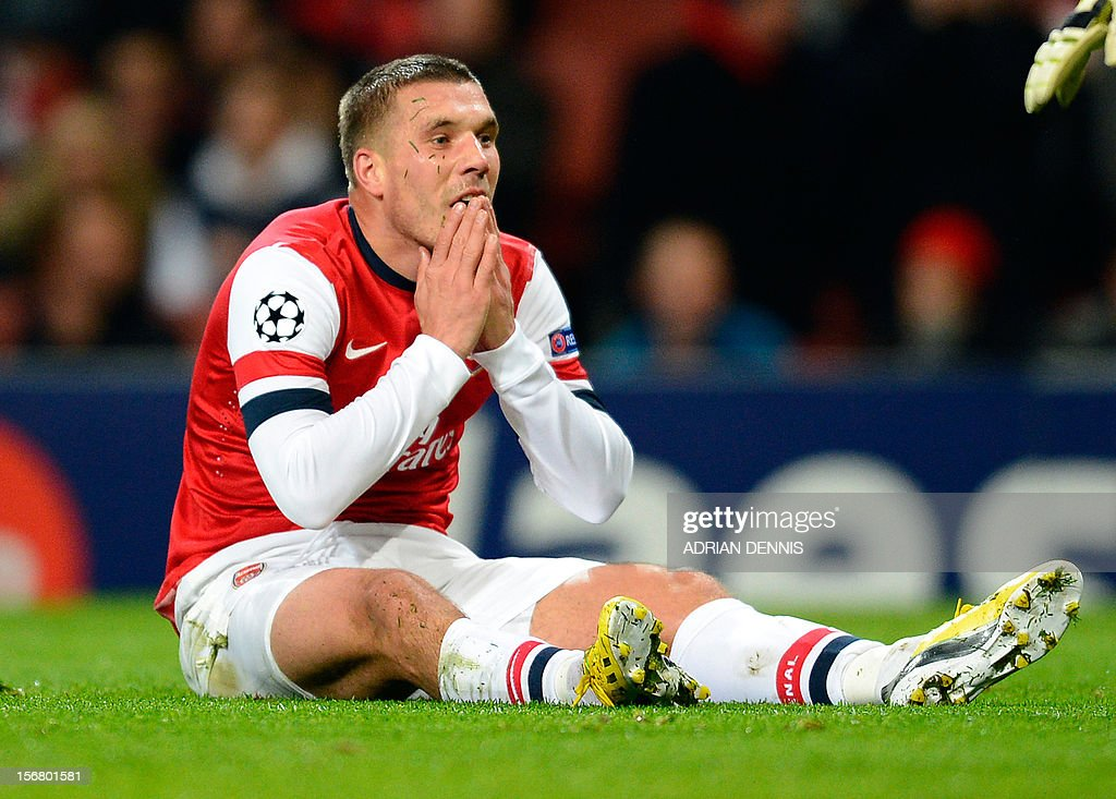 Arsenal's German striker Lukas Podolski reacts after missing a chance on goal during the UEFA Champions League group B football match against Montpellier at the Emirates Stadium, North London on November 21, 2012.
