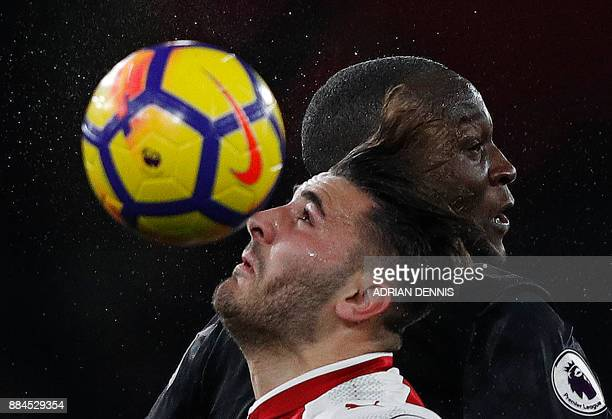 Arsenal's Germanborn Bosnian defender Sead Kolasinac and Manchester United's Belgian striker Romelu Lukaku vie to head the ball during the English...
