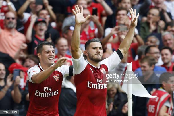 Arsenal's Germanborn Bosnian defender Sead Kolasinac celebrates with Arsenal's Swiss midfielder Granit Xhaka scoring the team's first goal during the...