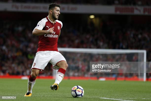 Arsenal's Germanborn Bosnian defender Sead Kolasinac looks to pass the ball during the English Premier League football match between Arsenal and...
