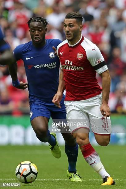 Arsenal's Germanborn Bosnian defender Sead Kolasinac runs away from Chelsea's Belgian striker Michy Batshuayi during the English FA Community Shield...