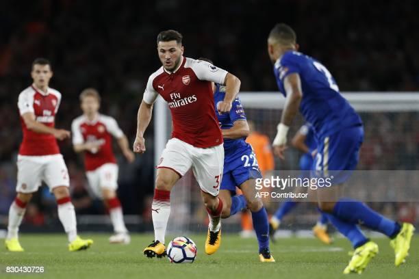 Arsenal's Germanborn Bosnian defender Sead Kolasinac runs with the ball during the English Premier League football match between Arsenal and...