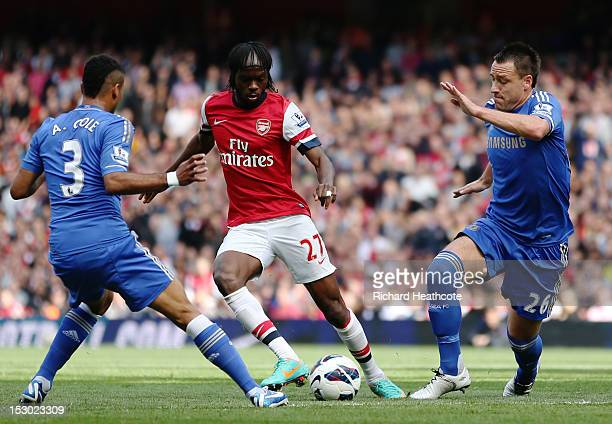 Arsenal's Gervinho competes for the ball against Chelsea's Ashley Cole and John Terry during the Barclays Premier League match between Arsenal and...