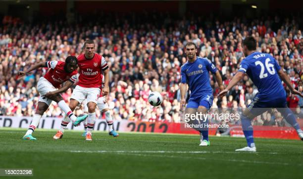 Arsenal's Gervinho scores their first goal of the match while Chelsea's John Terry defends during the Barclays Premier League match between Arsenal...