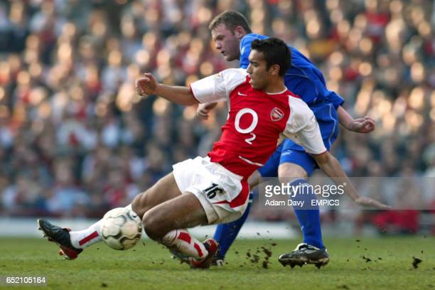 Arsenal's Giovanni van Bronckhorst slides in to tackle Everton's Wayne Rooney