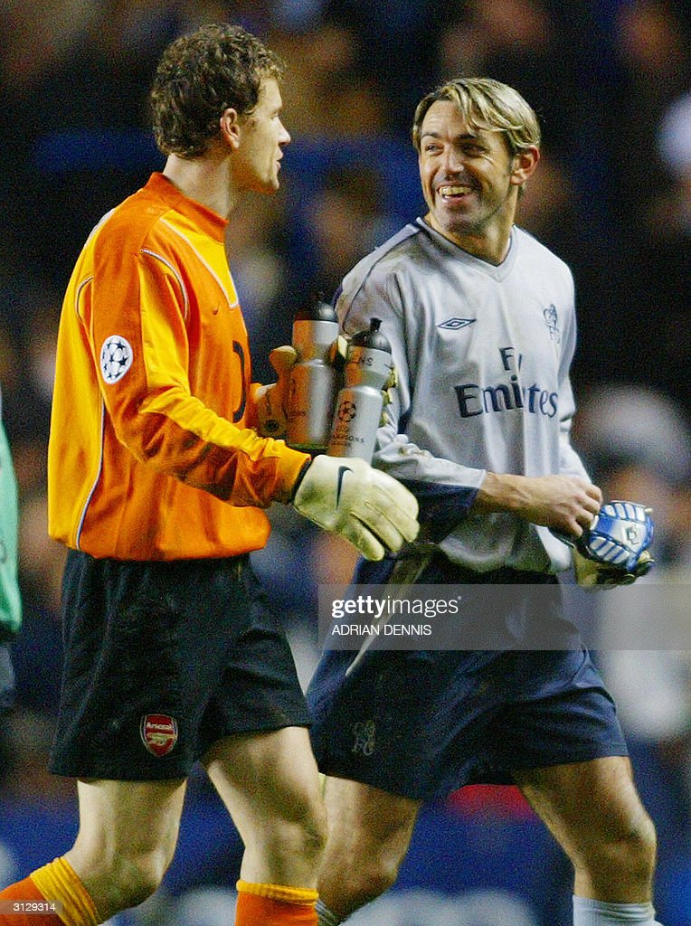 Arsenal's goal keeper Jens Lehman walks off of the pitch with Chelsea's goal keeper Marco Ambrosio after their Champions League quarter-final football match 24 March, 2004 at Stamford Bridge, London. Chelsea and Arsenal tied 1-1.