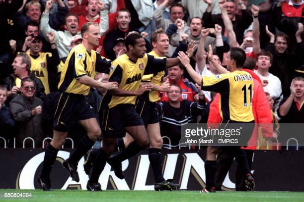 Arsenal's goalscorer Thierry Henry is congratulated by Dennis Bergkamp Mark Overmars