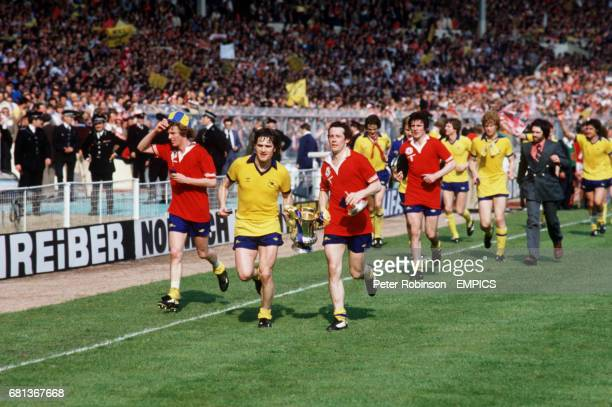 Arsenal's Graham Rix Pat Rice and Liam Brady lead their teammates on a lap of honour with the FA Cup after their dramatic 32 win followed by teammate...
